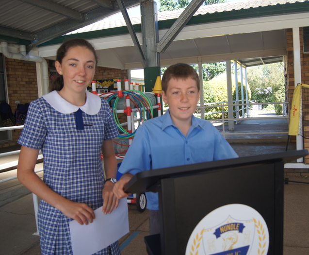 Two students standing at a podium.